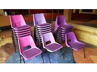 Stacking plastic chairs with cushion seats