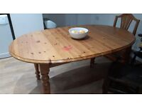 Extending pine dining table