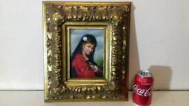 Oil painting of lady in wood carved gold frame