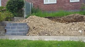 Loose turned soil and stone ideal for hard core or filling in.