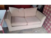 Two seater light colour sofa bed. Delivery.