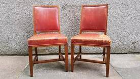 Pair of oxblood red leather antique bedroom hallway chairs