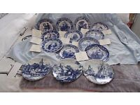 11 Wedgewood collectable plates plus 3 Delft Blauw.