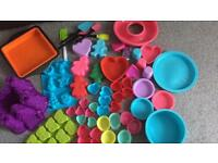 Massive collection of barely used silicone cooking moulds