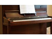 acoustic upright piano in good working order