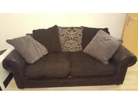 Sofa - Textured black fabric in good condition