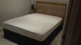 Ottoman double bed with mattress and wooden headboard
