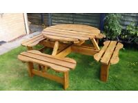 Large round wooden picnic garden table with 4 benches (8 seats)