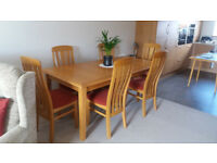 Light Oak Dining Table With Eight Matching Chairs.