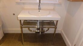 Ceramic basin with heated chrome plated towel rail