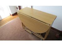 Fold up table and two chairs for sale