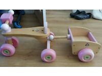 ELC wooden trike and taylor in pink.