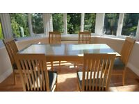 Light wood & glass extending table with 6 chairs