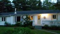 Charming furnished bungalow with acreage