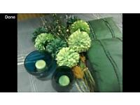 Teal cushions vases and flowers