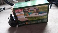Blow up double mattress with battery powered pump
