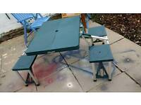 Picnic table with 4 seats.