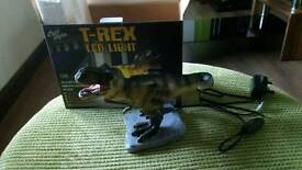 Child's t-rex dinosaur led light. Brand new with box and packaging