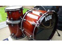 Natal Walnut Original US Rock drum kit in Deep Sunburst with brushed nickel lugs, hoops and legs.