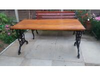 LARGE GARDEN TABLE WITH WOOD SLATTED TOP AND VINTAGE CAST IRON ENDS