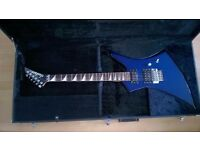 Jackson Kelly KE3 explorer-style electric guitar with hardcase