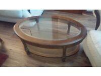 "Coffee table. Oval. 41""x25""x15"""