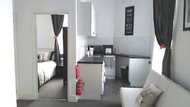 One Bed First Floor Furnished abode with open plan living /dining area, kitchen & shower room