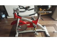 Cardio studio Spinning class exercise bike with monitor, excellent condition