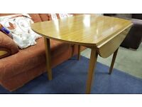 Vintage Round Drop Leaf Table in Good Condition