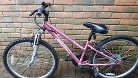 "Apollo vivid 20"" girls bike in pink. Front suspension, Shimano equipped. Age 7-10 years"