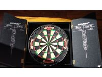 Dart board for sale hardly ever used