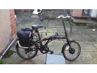 nearly new mens eletric folding bike with lots of accessories