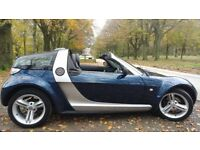 Smart roadster coupe. Heated leather seats, paddle shifters.