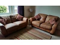 Two brown leather sofas