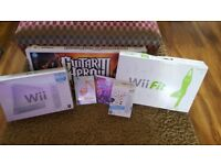 Nintendo Wii + Wii Fit + Guitar Hero 3+ wii sports + Wii music