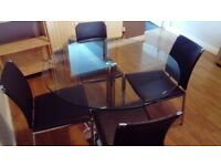 Circular glass-top kitchen table and 4 chairs - good condition