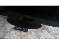 Samsung 40 Inch LED 1080p Television with remote control.