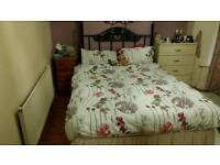 Double divan bed with mattress and decorative head post