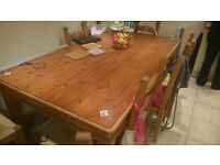 6 to 8 person dining table and matching chairs