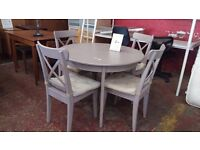 Hardwood round painted dining table and 4 chairs
