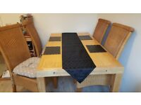 kitchen table with strong wickers chairs
