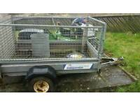 Indespension trailer with tailgate for ramp. Got spare wheel also has eye towbar