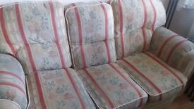 Sofa and two armchairs in good condition.