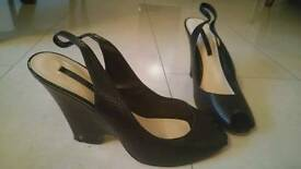 Black peep toe wedge shoes. Size 8