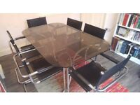 Smoked Glass Top And Chrome Legs Dining Table With 6 Matching Black Faux Leather