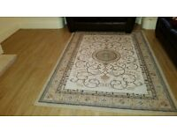 large beautiful beige area rug 5ft by 7 ft