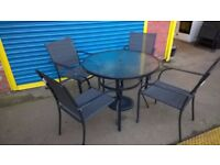 OutdoorGarden Table and 4 Stacking Chairs for sale