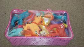 Box of toy ponies