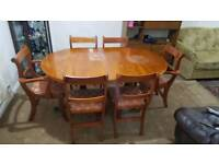 Large oval foldable dining table with 6 chairs