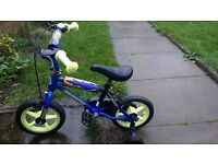 Boys bike with support wheels and a bell